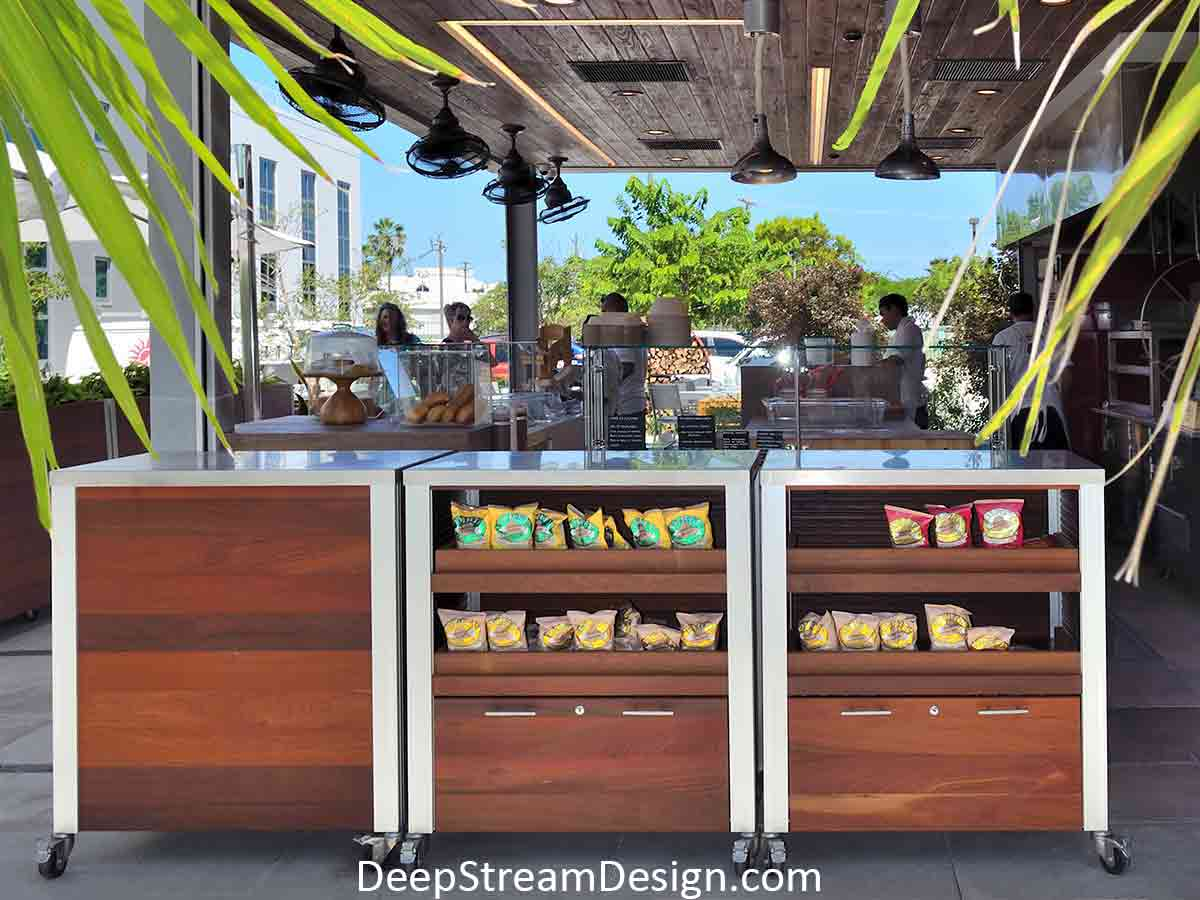 DeepStream's custom Ipe Wood and 316 stainless steel outdoor Restaurant Food Service Carts and large Planter on wheels create a tropical island cafe's upscale but casual ambiance.