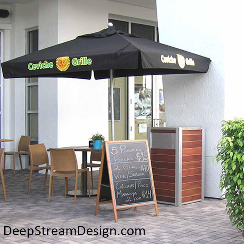 Modern Commercial Combination Restaurant Trash Receptacle complements restaurant planters at an outdoor sidewalk café.