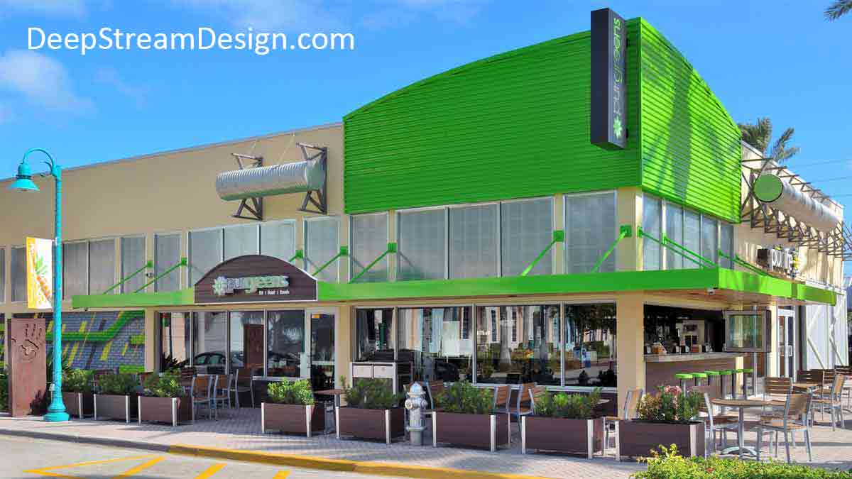 8 dark brown recycled plastic restaurant planters, and a combination recycling and trash receptacle, create a sidewalk dining area in front of bright lime green tropical restaurant.