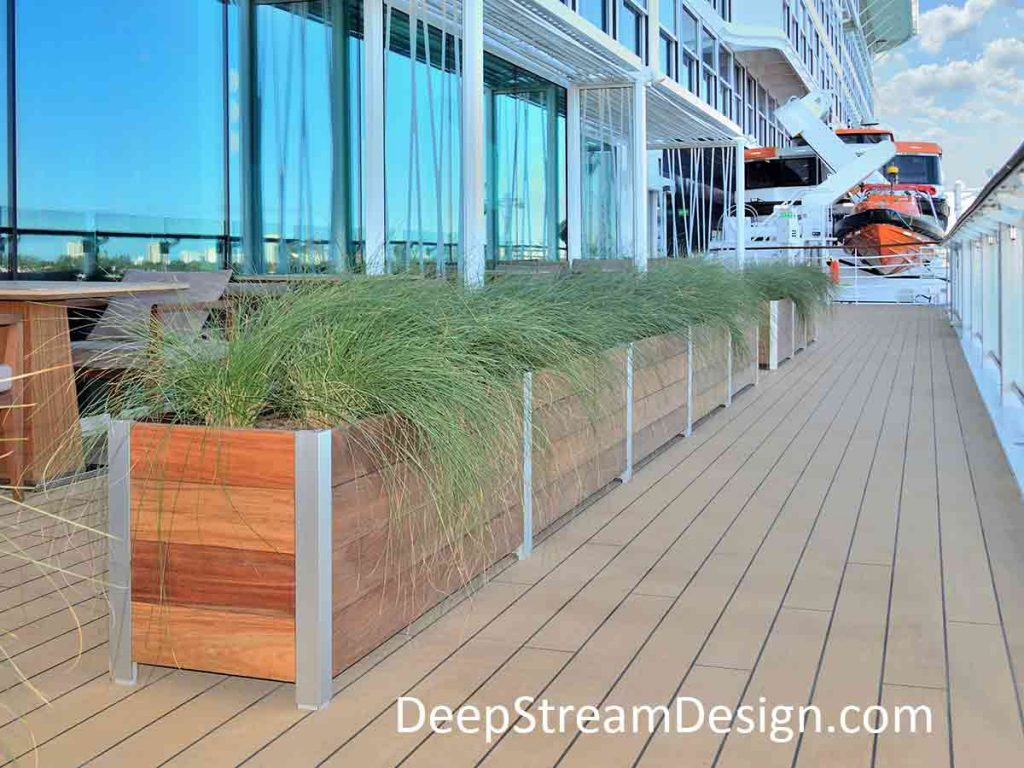 Rugged enough for a life at Sea. A long Multi-section Wood Planter on the Celebrity Edge cruise ship creates a defined area for a dining on the outside midship edge of the vessel for a popular fine dining venue.