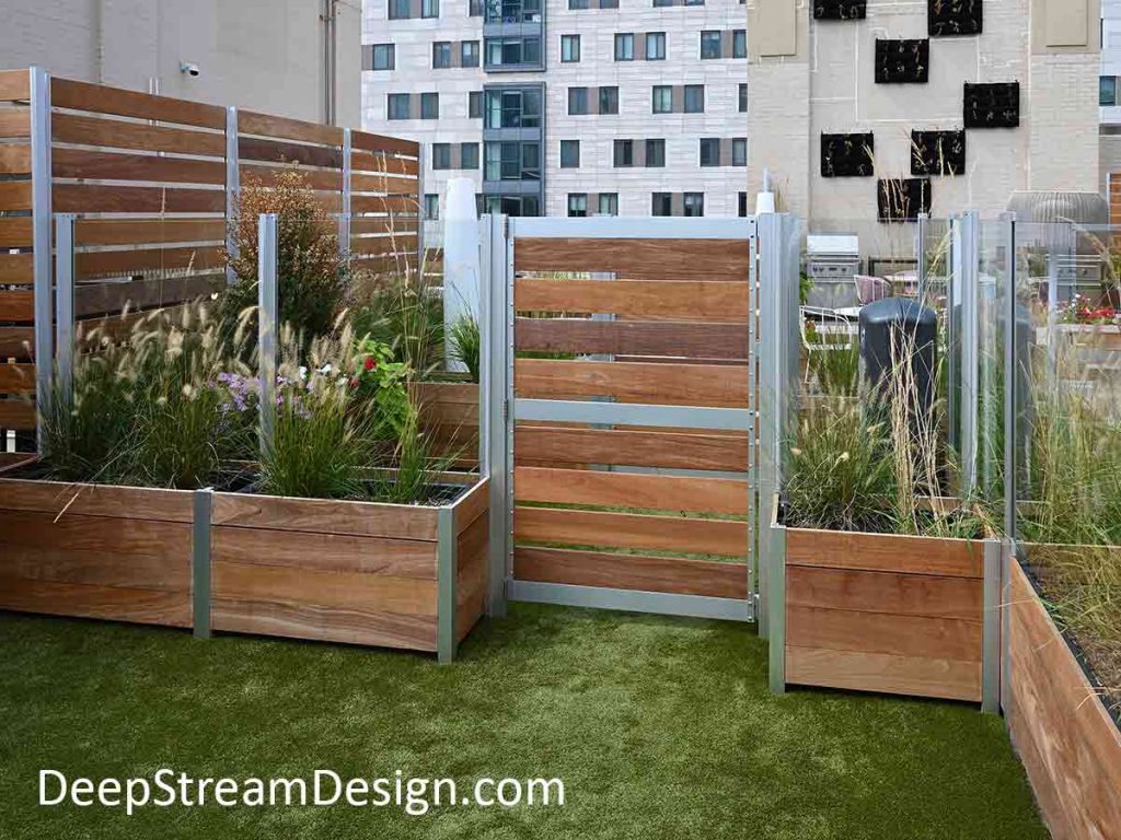Mariner Planter-mounted glass and wood screen wall and gate form a dog park on a urban roof deck.