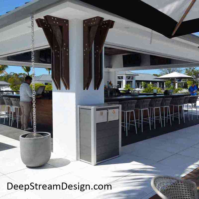 Modern slate grey Recycled Plastic Lumber Combination Restaurant Trash and Recycling Receptacle at a modern upscale pool club bar.