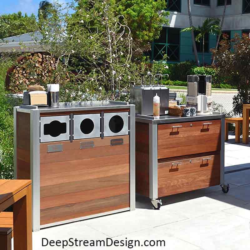 Modern Combination Recycling and Trash Receptacle with companion Ipe Food Service cart with stainless steel tops outside at a tropical island restaurant.