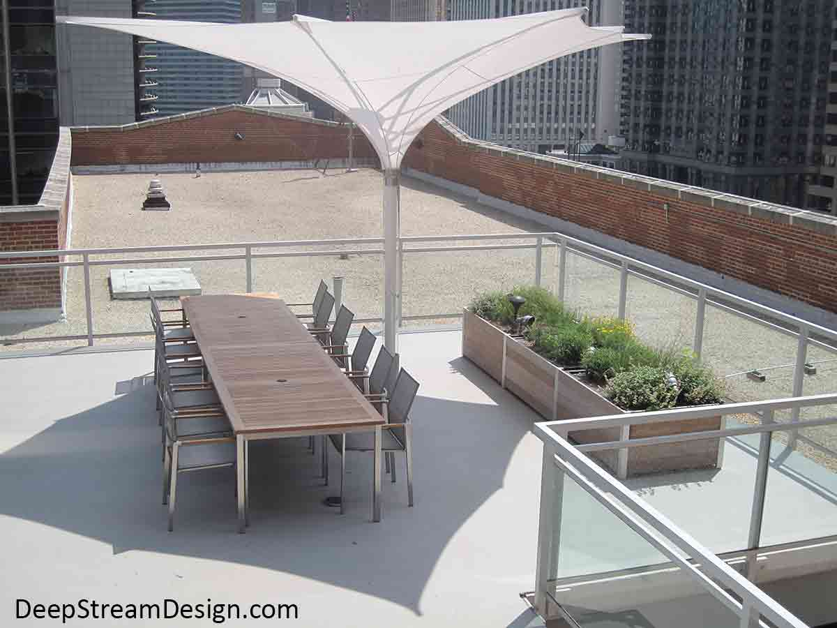 Large modular multi-section restaurant planters are a perfect way to grow fresh herbs for this urban roof deck test kitchen restaurant flanked by skyrise buildings on the Chicago River.