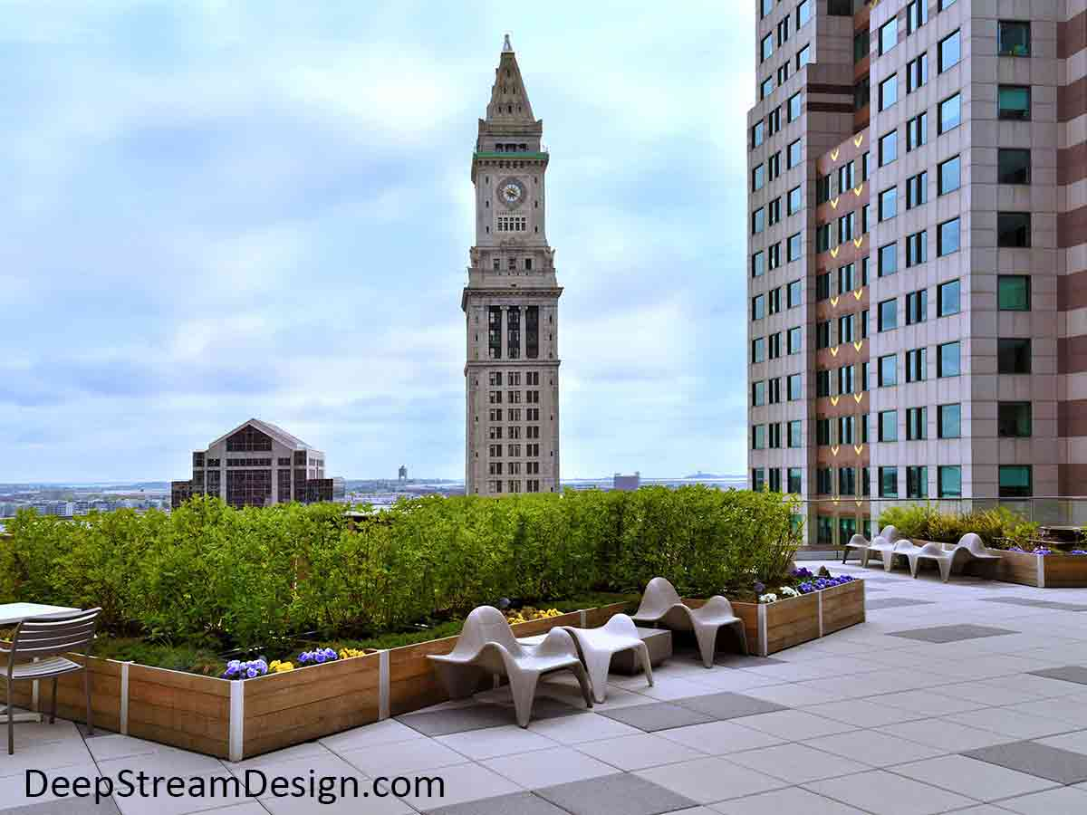 Exceptionally large, Long Wood Garden Planters, lushly landscaped with flowers and bushes on Boston's Historic Exchange Place 14th floor roof deck with the famous Customs House clock tower in the immediate background.