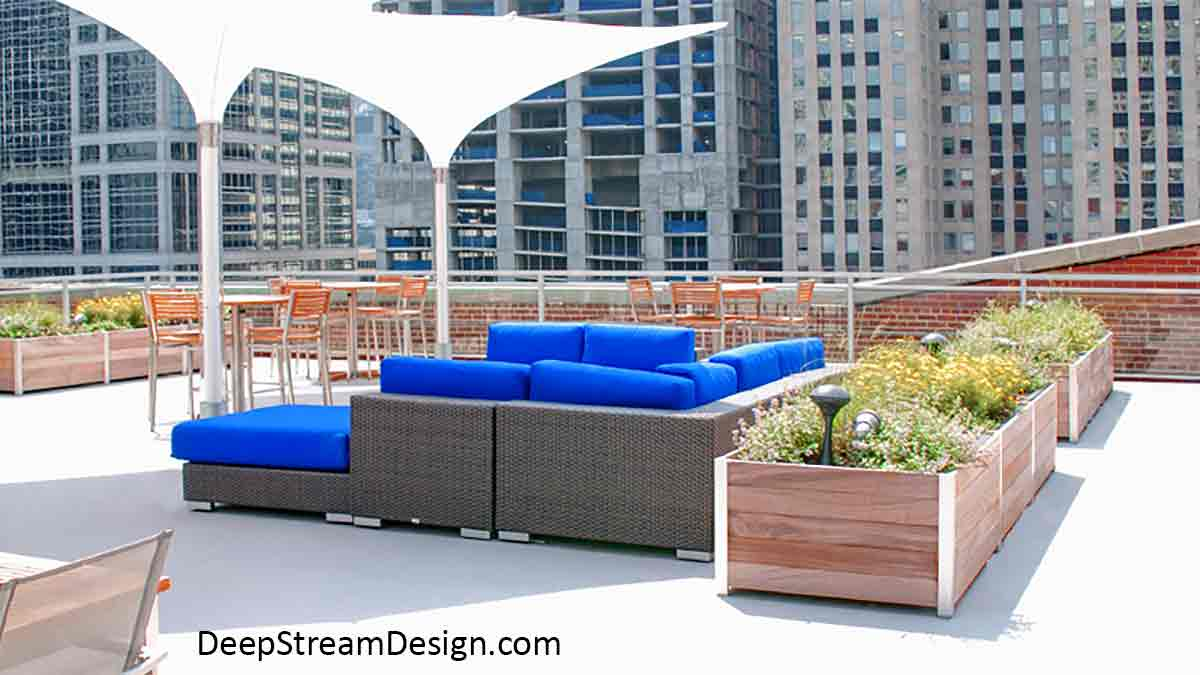 Long Wood Garden Planters complete with food safe waterproof planter liners are a perfect way to grow fresh herbs for this urban roof terrace lounge and test kitchen restaurant flanked by skyrise buildings on the Chicago River.