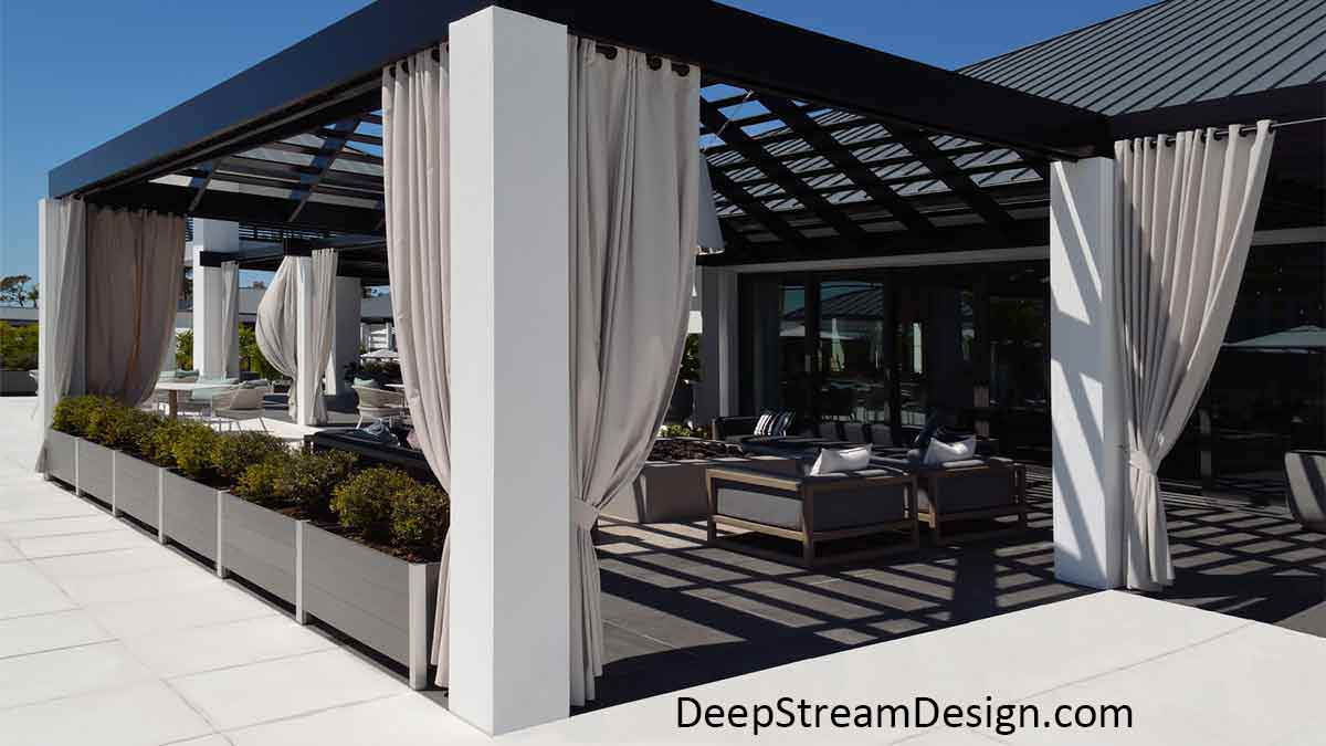 Chic modern Food Safe Plastic Planters in slate grey no-maintenance recycled plastic lumber and anodized aluminum control access to a modern clubhouse outdoor lounge with long white curtains pulled back around a ceiling shade grid open to the bright blue sky.