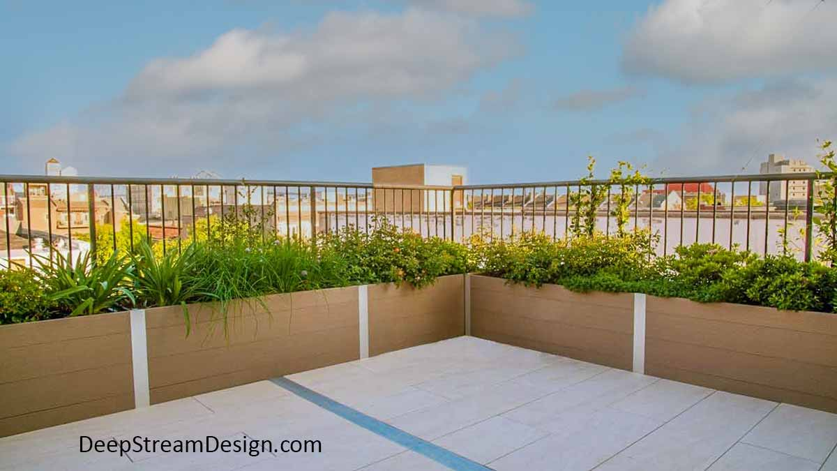 Commercial Long Wood Garden Planters crafted with no-maintenance Ipe brown recycled plastic lumber create a landscaped parapet wall for an urban roof terrace with a built-in look.