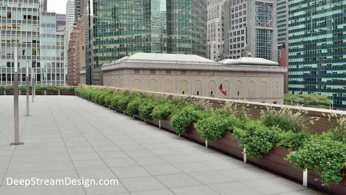 An 800 ft. continuous run of Long Wood Garden Planters, crafted with brown recycled HDPE plastic lumber and our unique structural modular aluminum frame and planter liners filled with flowering plants and ornamental grass, creates a natural parapet wall on a midtown Manhattan roof deck surrounded by skyscrapers.