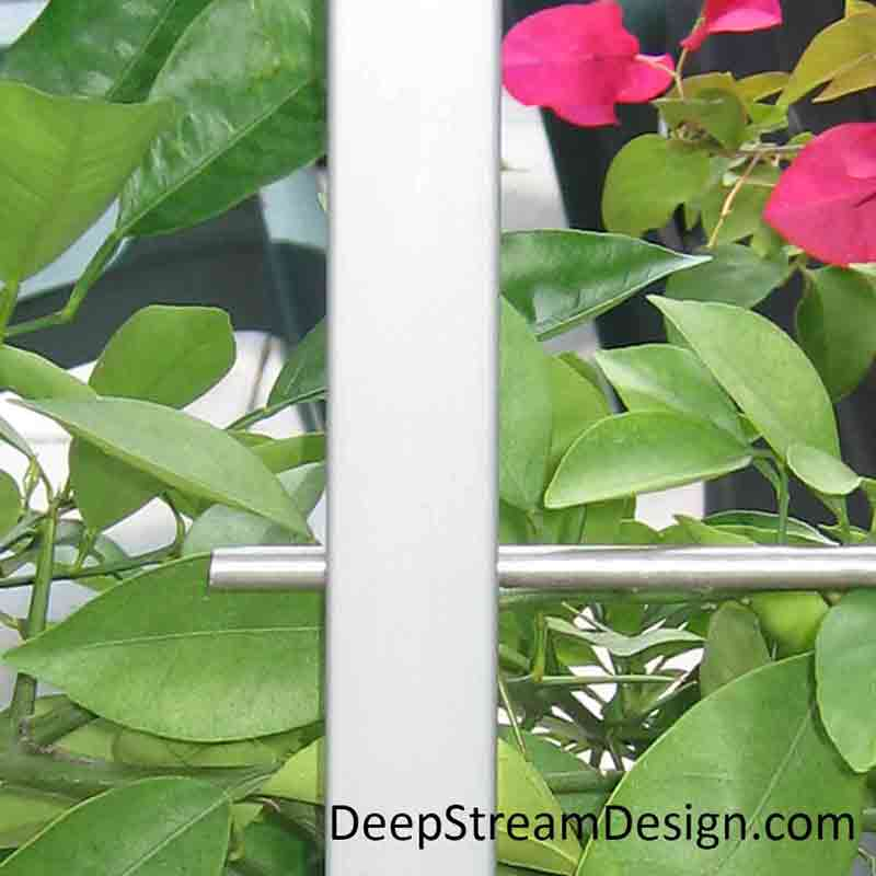 A close-up detail of a Planter with a Trellis made with cost effective square anodized aluminum uprights and 316-stainless steel rods.