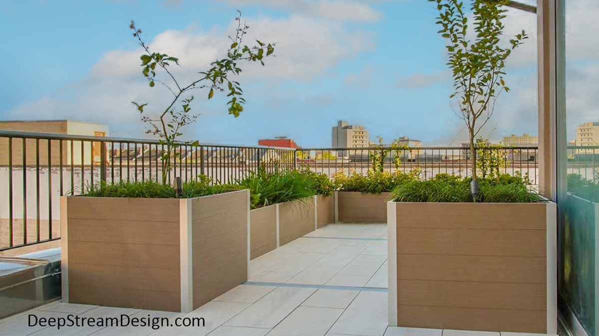 Modern Long Wood Garden Planters crafted with no-maintenance Ipe Brown recycled plastic lumber create a landscaped parapet wall for an urban roof terrace with a built-in look.
