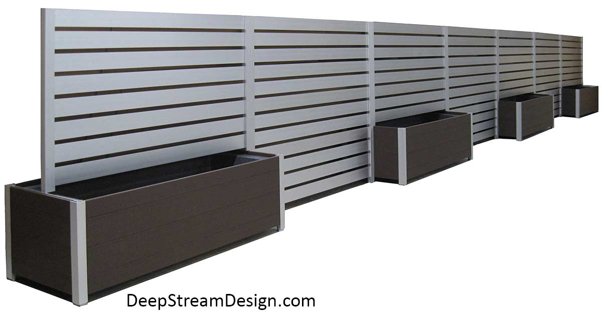 Studio photo of a modular commercial Long Wood Garden Planters with 7 silver anodized aluminum screen wall panels down the center. This modular planter is crafted with no-maintenance Ipe Brown recycled plastic lumber.