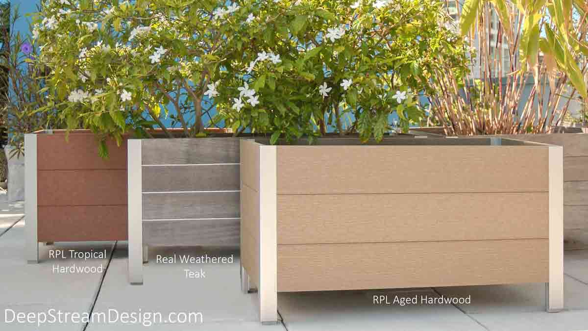 Three landscaped planters on a tropical roof deck. Two planters made with recycled plastic lumber flanking one made with aged Ipe Tropical hardwood to contrast color and finishes.