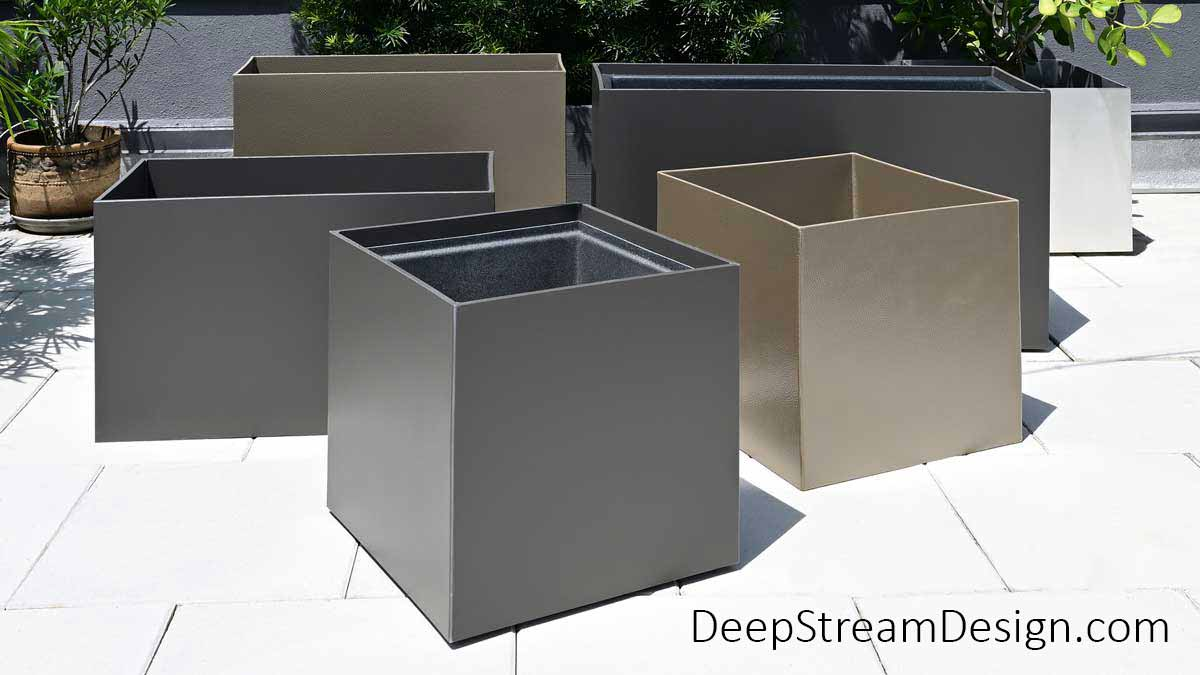Modern tall and short, square and rectangular Food Safe Plastic Planters on Wheels are shown in a tropical Miami roof deck setting.