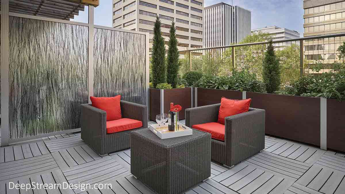 An Outdoor Screen Wall with opaque 3form panels creates a private seating area on a high balcony terrace with large wicker armchairs and bright red cushions in front of long planters with screen glass wall overlooking the street.