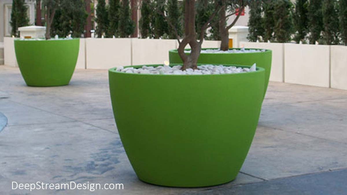 Sleek, simple, and elegantly proportioned, the collection of Urban round Fiberglass Garden Planters enhance modern landscape and architectural design. These bright lime green extra-large Urban garden planters are designed to be durable even when used to block off traffic locations like this passenger drop off area.
