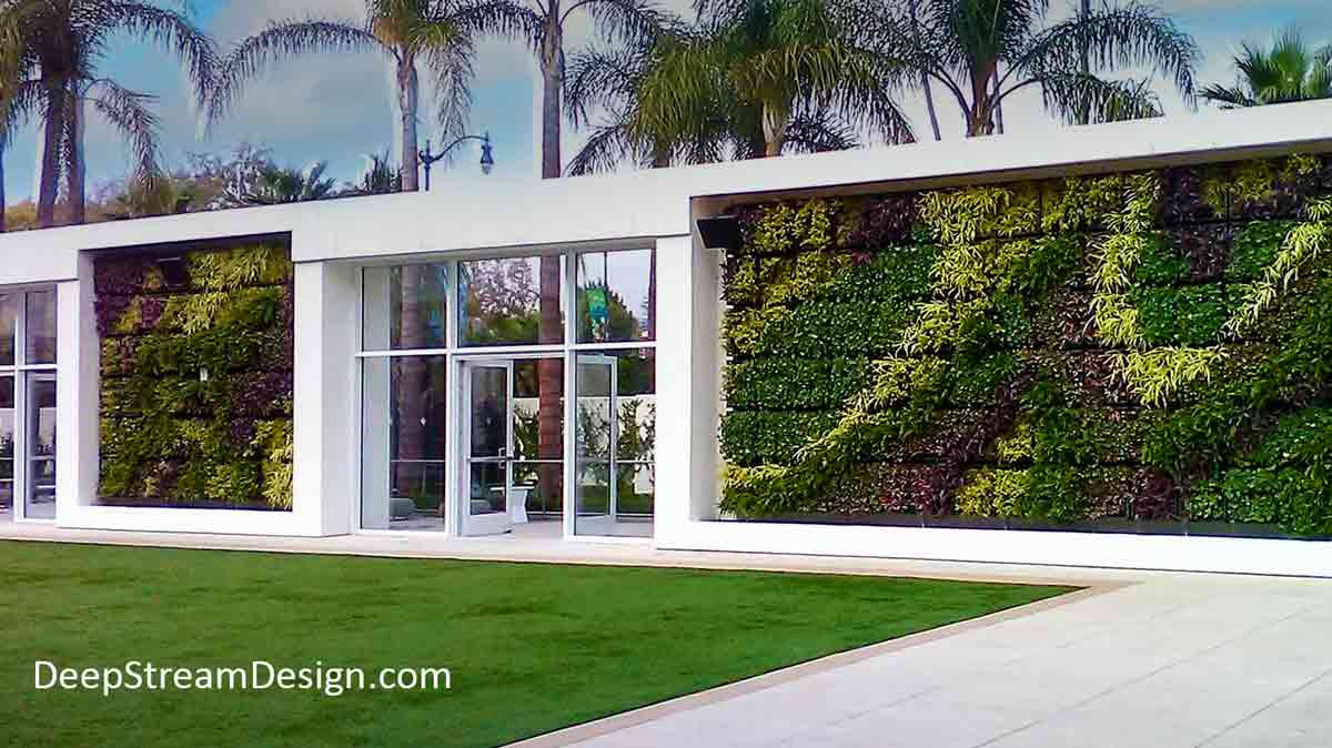 A tall, thick, freestanding Exterior Live Wall with an impressive modern glass and stainless-steel entrance way at the Beverly Hills Waldorf Astoria Hotel was created using Tournesol VGM® modular Live Wall System.