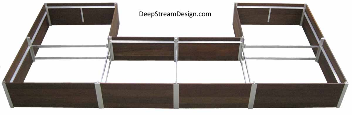 Studio photo showing a very Large Wood Garden Planter 21 inches deep created with DeepStream's trademark proprietary structural aluminum frame with cross bracing in a U shape with the longest side 24 feet long by 16 feet on the ends. Although this planter was designed with modular stock planter liners sitting directly on the deck, it is too shallow for trees, but it gives you an idea of how large and versatile DeepStream's modular planter system can be.
