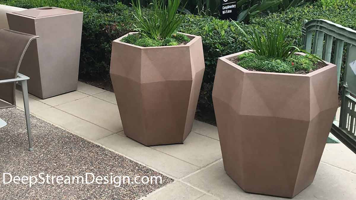 Two tall angular modern commercial Harlie Fiberglass Garden Planters add visual interest on the patio of a professionally landscaped town house patio.