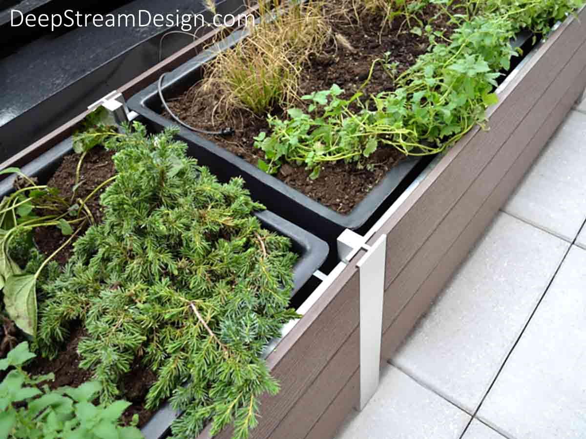 A rooftop installation of Large Wood Garden Planters showing how the internal T leg joins sections, supporting separate waterproof planter liners while hiding the drip irrigation and drainage systems.
