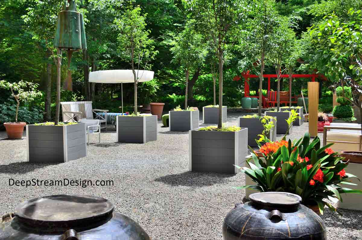 8 DeepStream Designs Large Planters for Trees in a landscaped forest clearing with seating and art installation at Long House Reserve in the Hamptons.