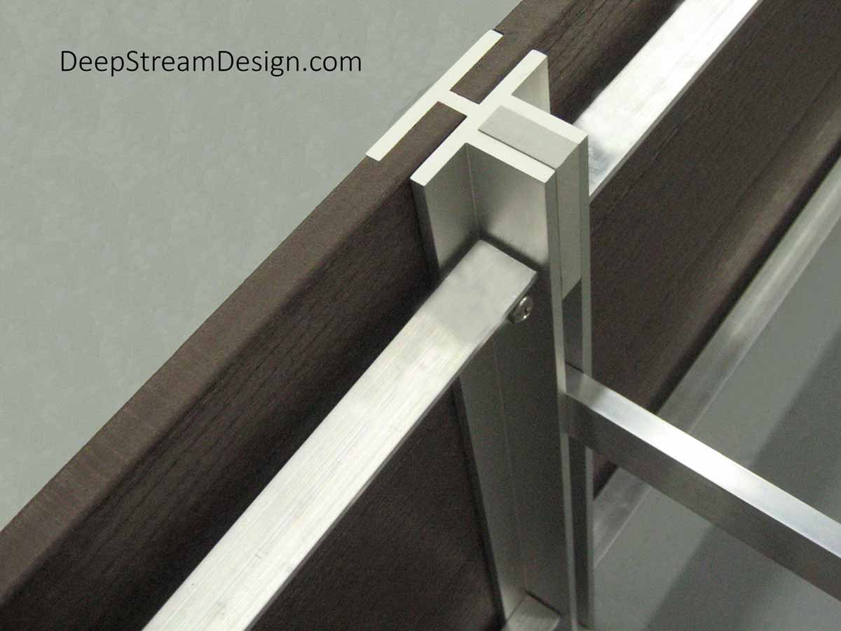 Studio photo showing the detail of the 6061-T6 aircraft aluminum structural frame, attached to DeepStream's trademark marine anodized extruded aluminum T leg, used to construct planters of any size rectilinear shape.