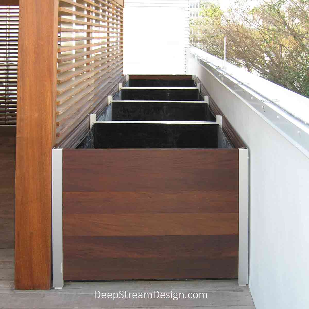 Every DeepStream planter uses proprietary anodized aluminum legs and engineered frame system to create custom Large Wood Planters for Trees and planter liners to exact dimensions at no extra cost ,as shown here between walls atop a chic Miami boutique hotel.
