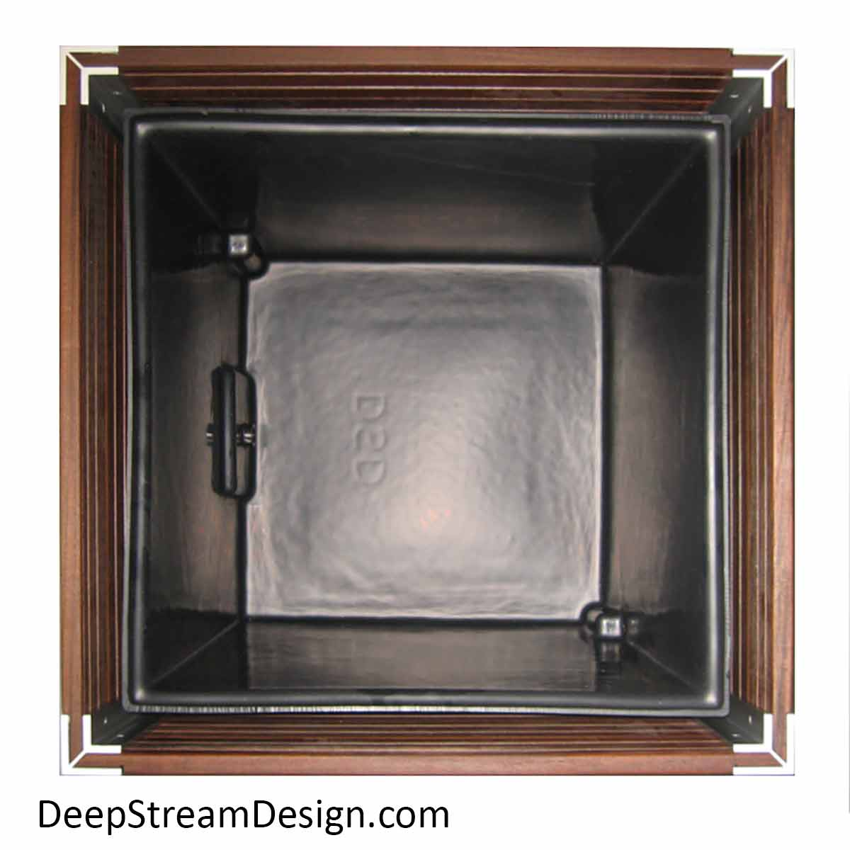 """Studio photo looking straight down into a 36"""" cube shaped Large Wood Planter showing the ¾ inch thick planks surrounding a separate inner black plastic planter liner."""