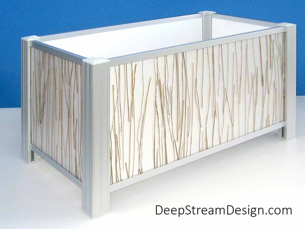 A studio photo of a Modern Planter using 3form Eco-resin Bear Grass panels with DeepStream's Audubon aluminum frame system that accepts any material with slide-in ease. 3form makes many innovative modern panel materials for both indoor and outdoor use.
