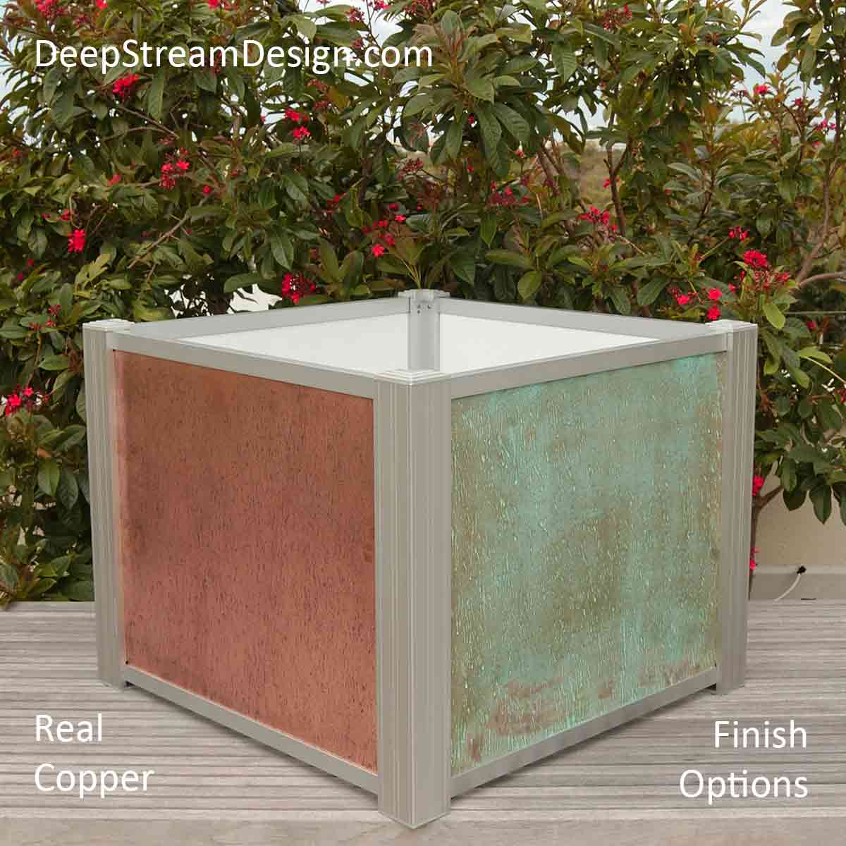 A Modern Planter, without its separate planter liner, created using natural copper panels held by DeepStream's Audubon aluminum frame system, which accepts any material with slide-in ease. Copper is perfect for indoor and outdoor use. The copper color is a natural finish, and the green verdigris finish often associated with aged copper is the result of chemicals applied in our workshop. Given modern air quality, copper will age to a brown finish.
