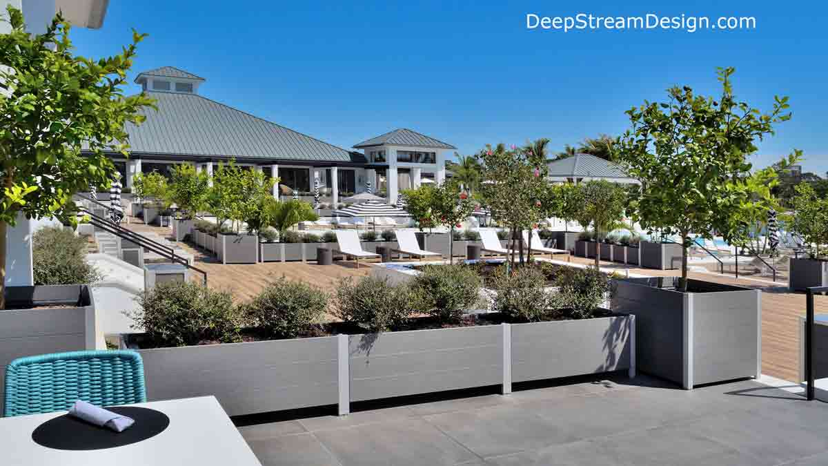 High-quality Modern Outdoor Planters, crafted from maintenance-free recycled plastic lumber, including Large Modern Planters for Trees, are landscaped to create a protective live parapet wall on stepped terraces between pool, sun beds, and club house decks.