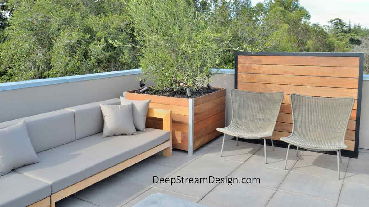 Modern Planters for Trees use special construction techniques to support tree growth over time. This olive tree on top of a modern office roof deck, complete with California modern couch and chairs, can grow to 12 feet and weigh over a ton. DeepStream's modern planters have a structural aluminum frames engineered to last for decades and encompass rugged rotomolded planter liners with advanced drainage systems.