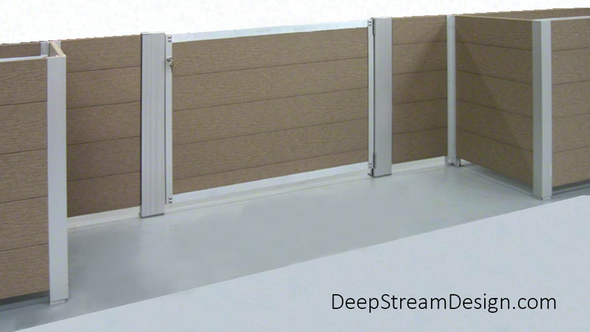 A studio photo showing how two wing walls can be mounted to Planters with Gates. DeepStream's proprietary marine anodized aluminum T leg forms one corner of the wood planter box allowing it to join the wing wall at one end. Our proprietary Intermediary extrusion is mounted to the deck with stainless steel feet at the other end of the wing wall to hold the gate on slide-in-easy hinges. The gate is shown closed.