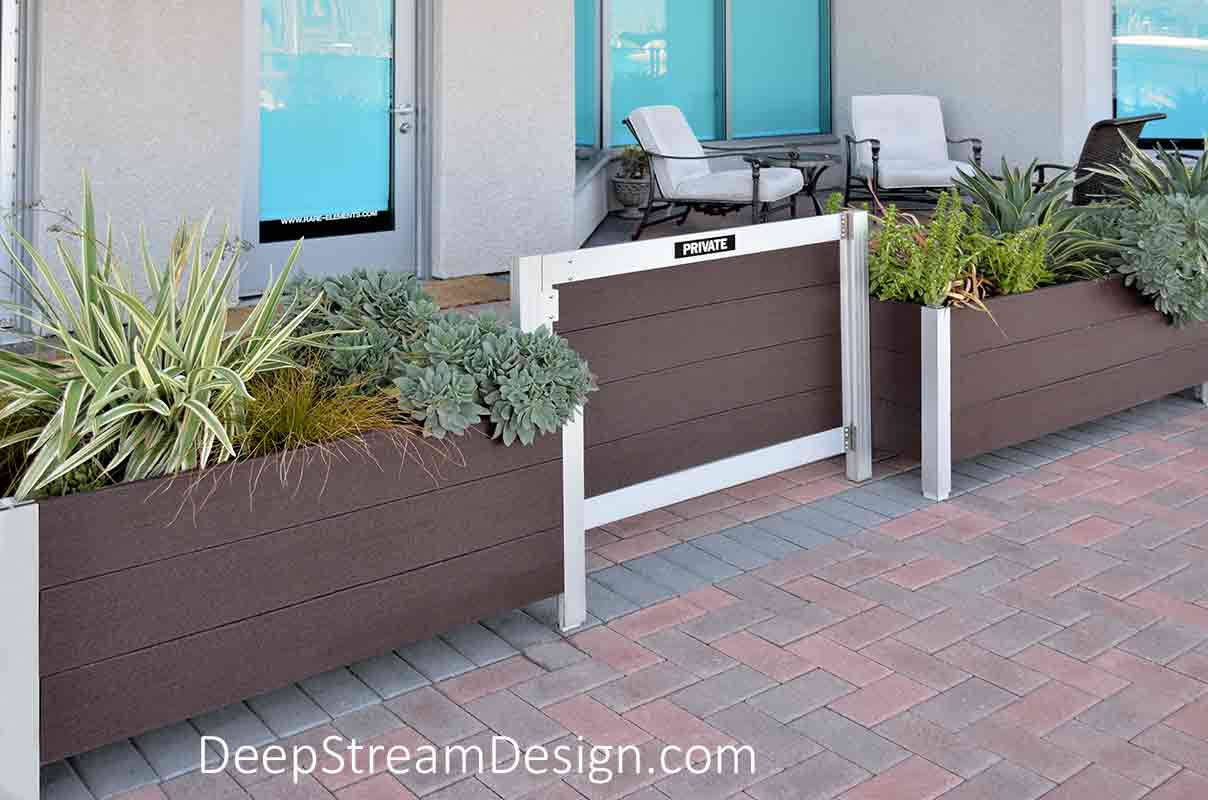Planters with Gates are an economical retrofit to soften a sidewalk area with landscaping that provides street level condos with private terrace areas at a seaside marina condo project at Marina del Rey.