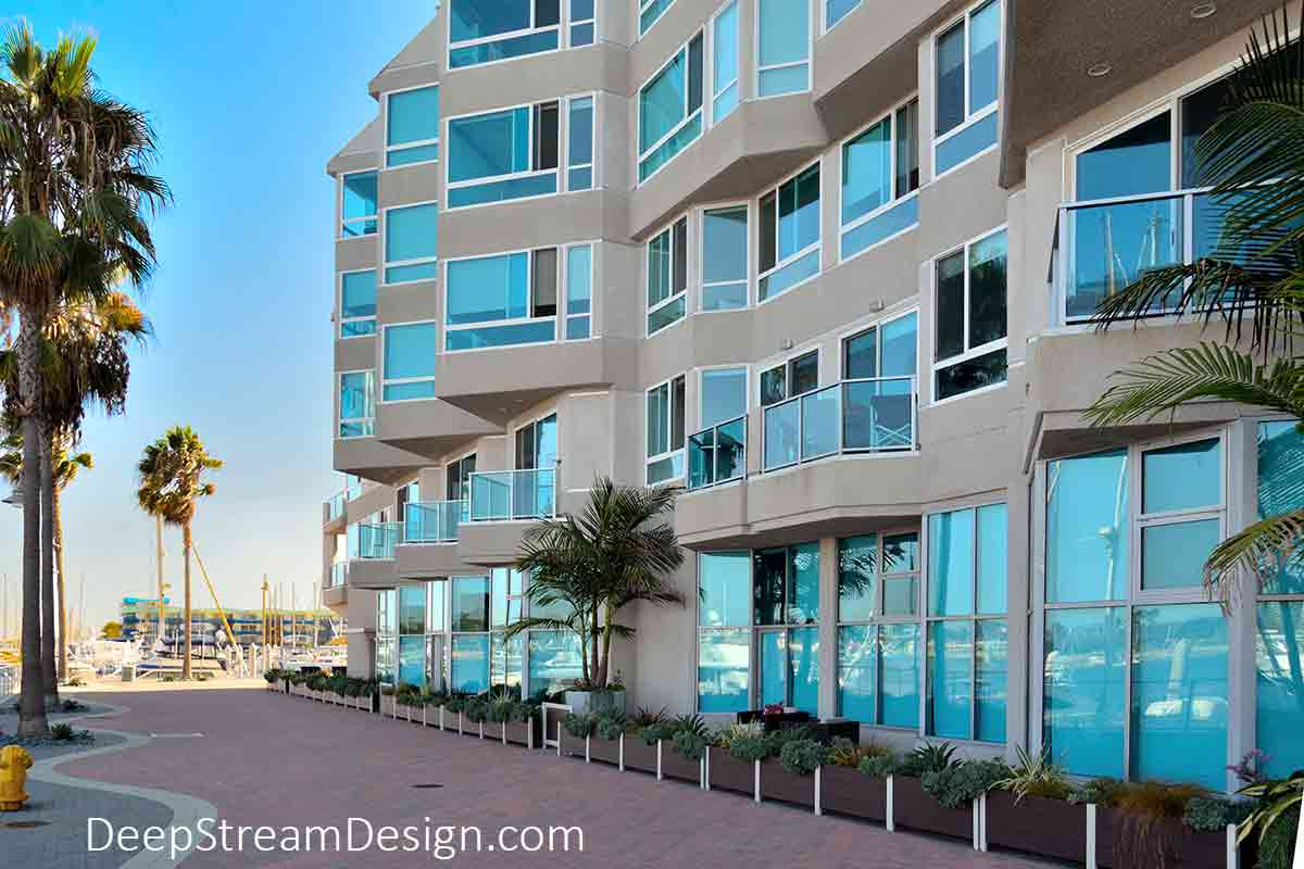 Planters with Gates are an economical retrofit to soften a sidewalk area with landscaping that provides street level condos with private terrace areas at a seaside marina condo project on the ocean at Marina del Rey.