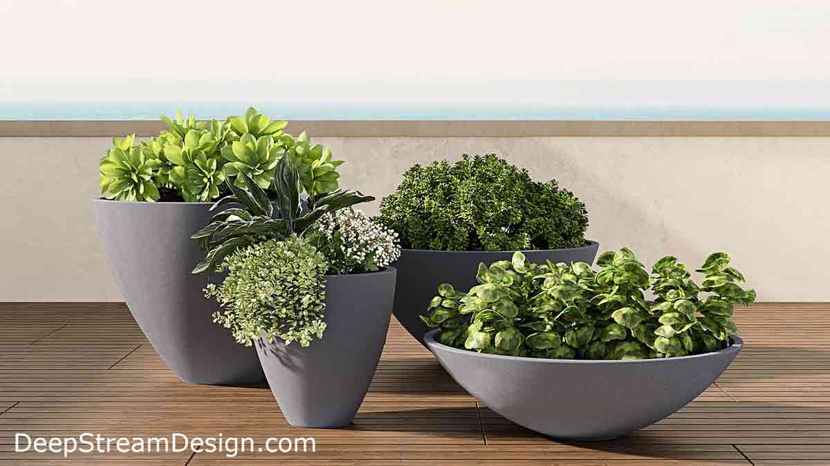Zena Collection of high quality Concrete Planters, seen here grouped on a wood deck, have a pronounced, highly tapered design. The lightweight grey GFRC Concrete Garden Planters are durable enough for high traffic locations, yet light enough to be moved and are available in 12 colors.