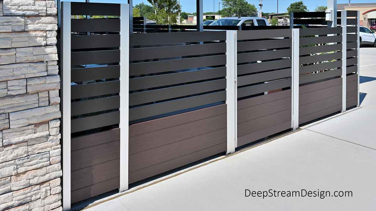 Detailed exterior view of DeepStream Designs' modular Mariner Long Wood Garden Planters with Gates that meet life safety codes for exits, an important part of the screen wall enclosing an upscale restaurant's outdoor smoking area.