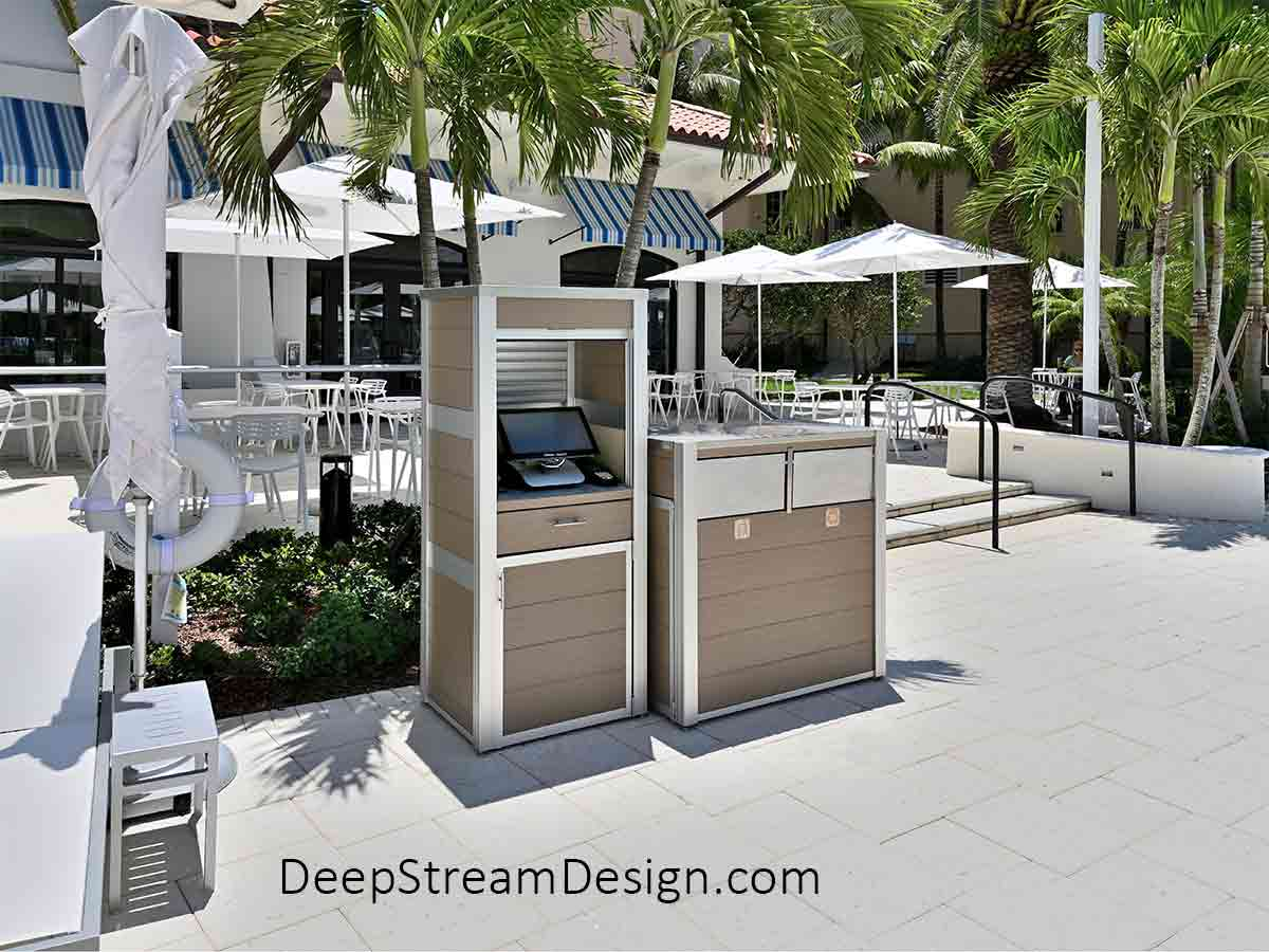 Custom Weatherproof Point of Sale Cabinets and Commercial Combination Recycling and Trash Receptacle located in the outdoor dining area between a tropical waterpark pool and a takeout restaurant with white chairs and large white umbrella.