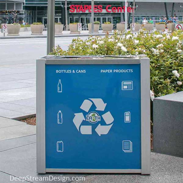 Audubon 21-gallon dual-stream modern commercial combined recycling and trash receptacle with quick-change advertising panel.