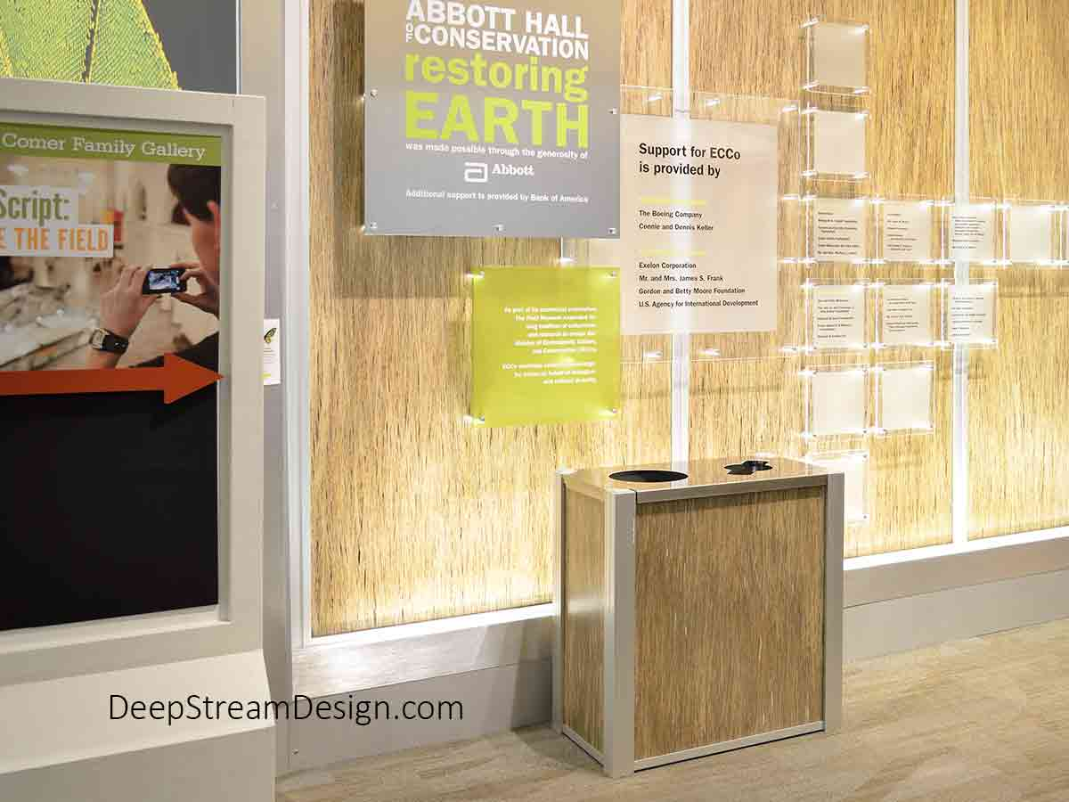 """DeepStream Audubon modern commercial combined recycling and trash receptacle with 3form natural reed Eco-Resin panels at the Chicago Field Museum used in the exhibit on Conservation and """"Restoring the Earth"""" to promote recycling and sustainable design."""
