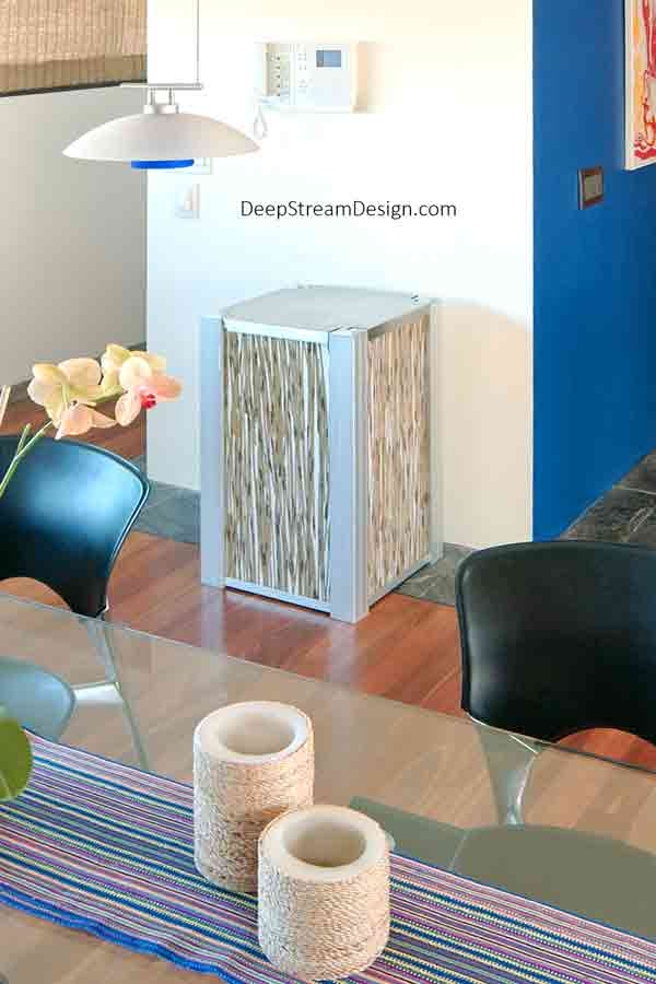 A beautiful home recycling bin, this DeepStream Audubon bin is crafted with 3form Eco-Resin panels that fit the modern decor of this designer Miami penthouse.