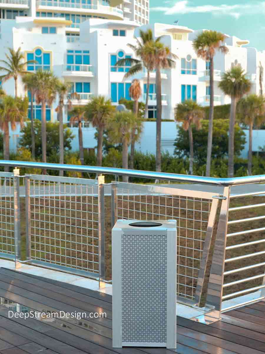Photographed at Miami Beach's ultra-modern South Pointe Park, DeepStream's modern commercial recycling or trash bin, crafted with 3-dimensional aluminum panels and framed by 316 stainless steel and anodized aluminum, is in its natural element.