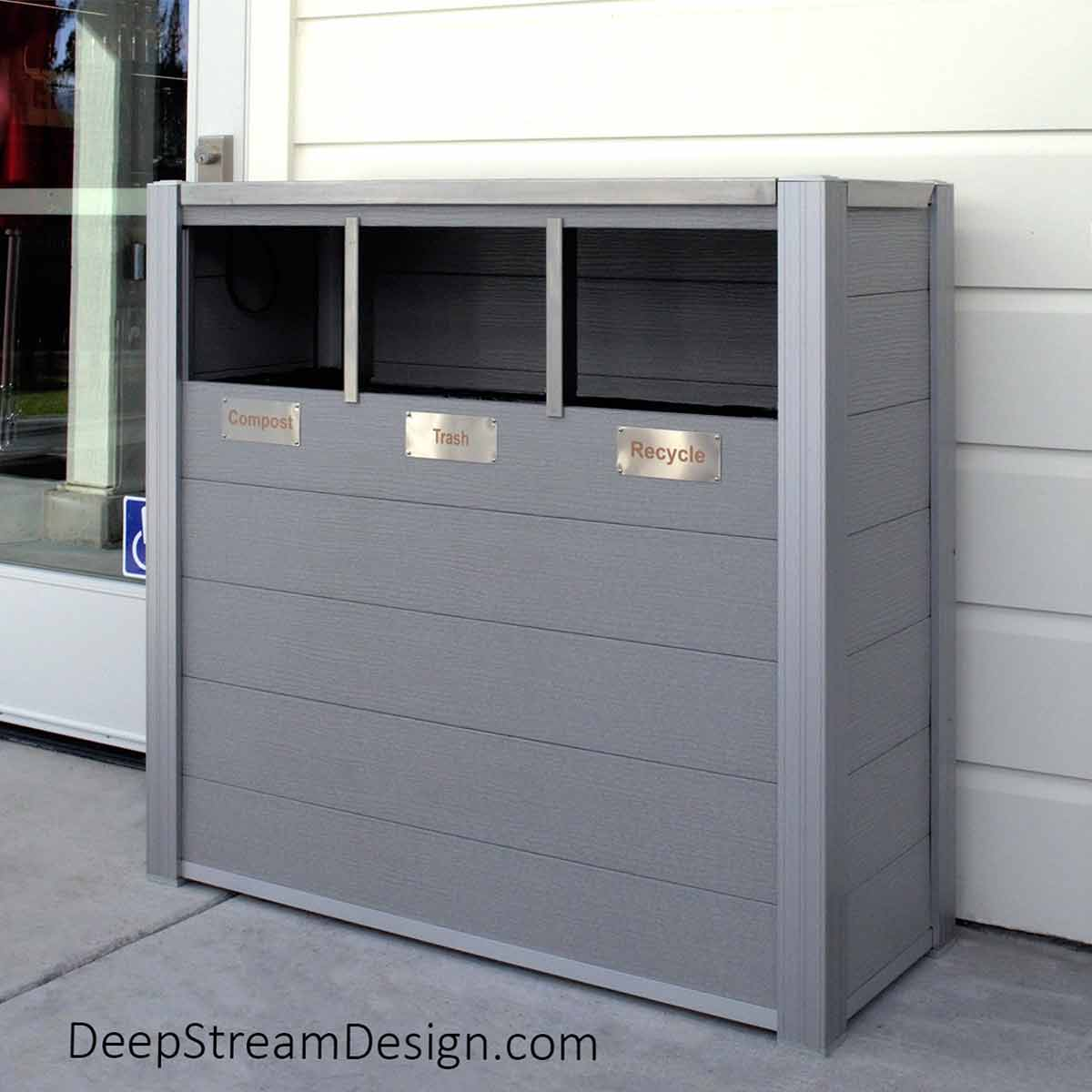 Oahu triple-stream Modern Commercial Combined Recycling and Trash Receptacle with 21-gallon leakproof inner bins, no touch openings, constructed with light gray recycled plastic lumber pictured in front of a Napa Valley resort's general store.