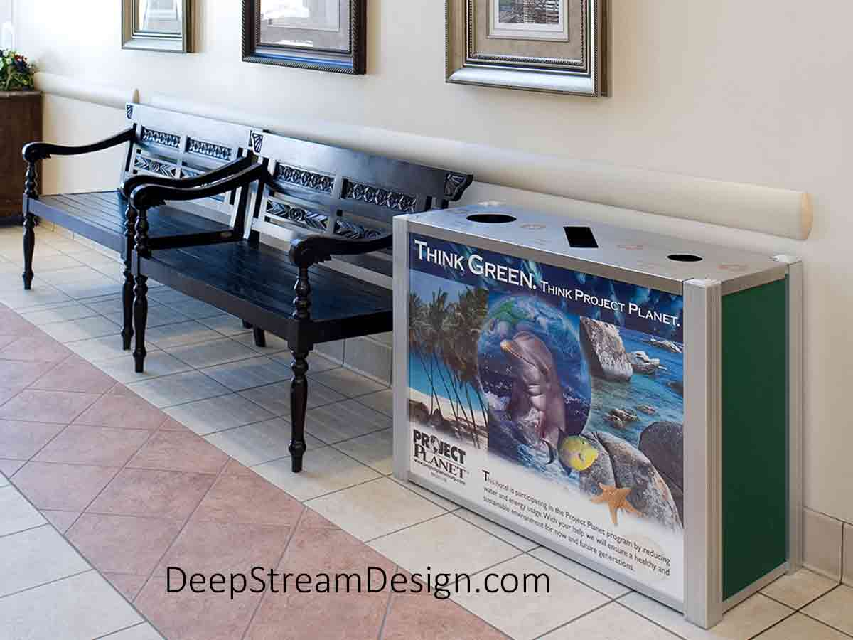 DeepStream Audubon triple-stream 21-gallon Commercial Combined Recycling and Trash Receptacles crafted with quick-change advertising panels at a US Naval Base Hotel promoting Project Planet a worldwide US Navy recycling project.