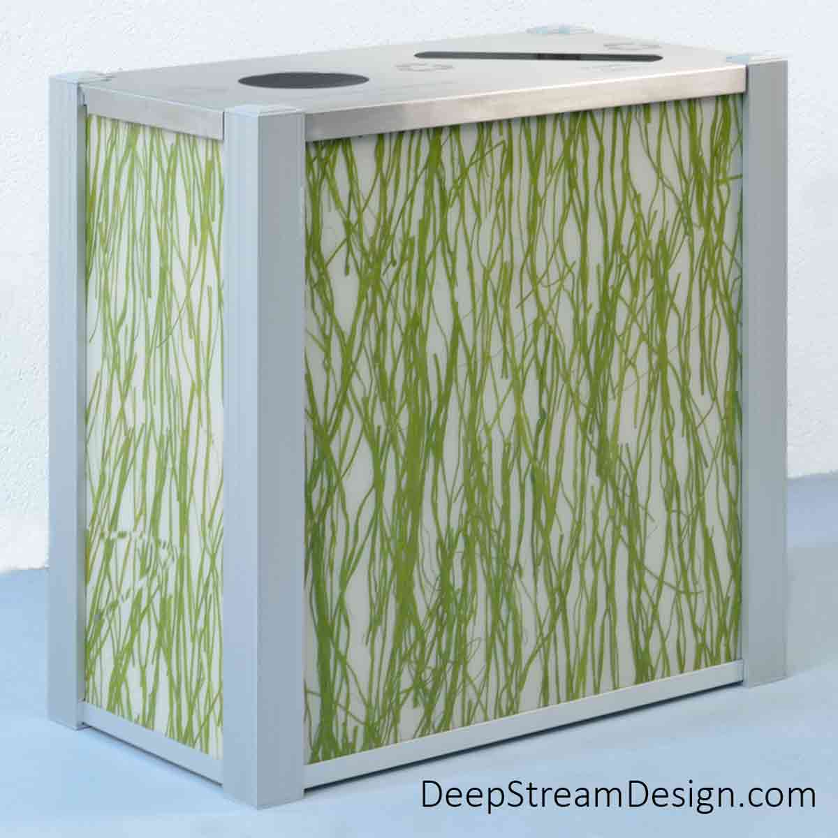 A studio photo of a dual-stream DeepStream Audubon modern commercial combined recycling and trash receptacle with 3form Eco-Resin panels crafted with green seaweed.
