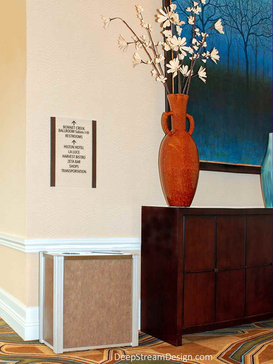 DeepStream Audubon dual-stream modern commercial combined recycling and trash receptacle with 3form Eco-Resin panels in the art-filled meeting room lobby of a 5-star convention center luxury resort hotel complex.