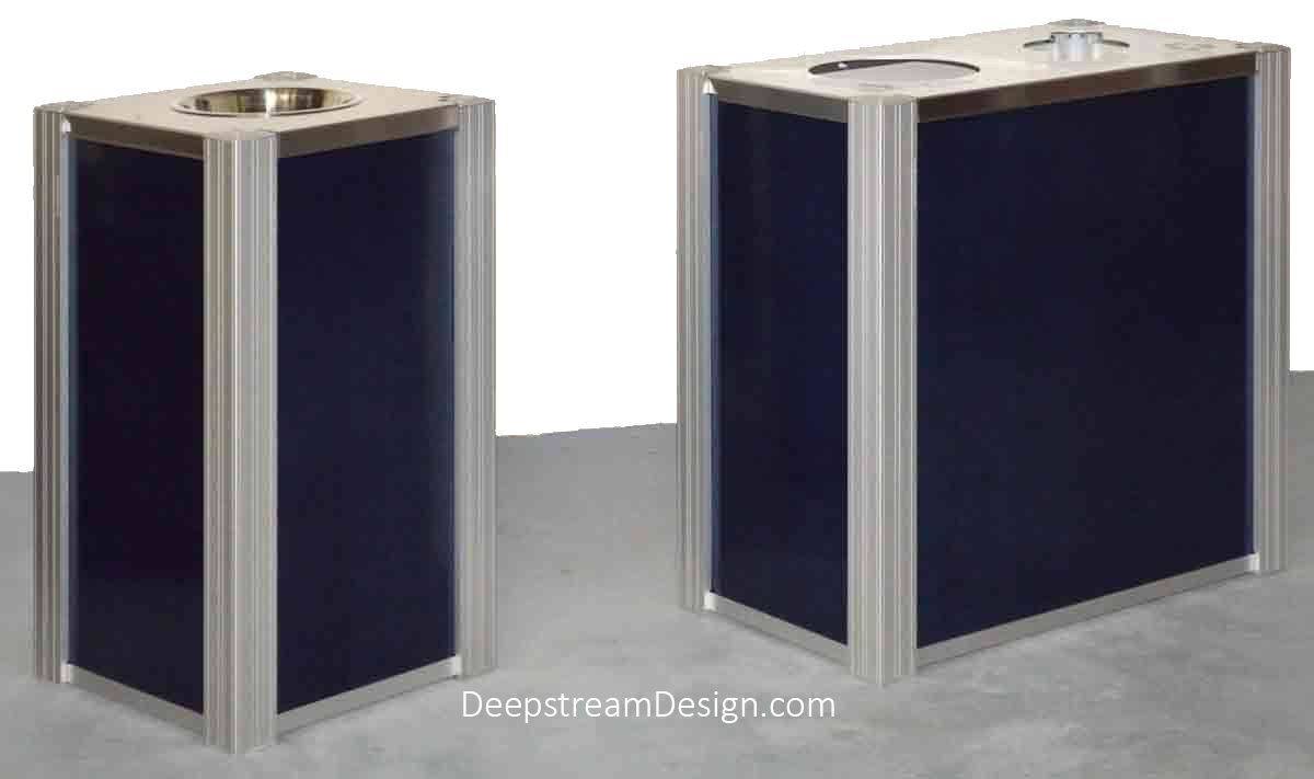 A studio photo of a DeepStream Audubon dual-stream 21-gallon modern commercial combined recycling and trash receptacle with dark blue aluminum skin alongside a matching ashtray stand with 316 stainless steel lid and ashtray.