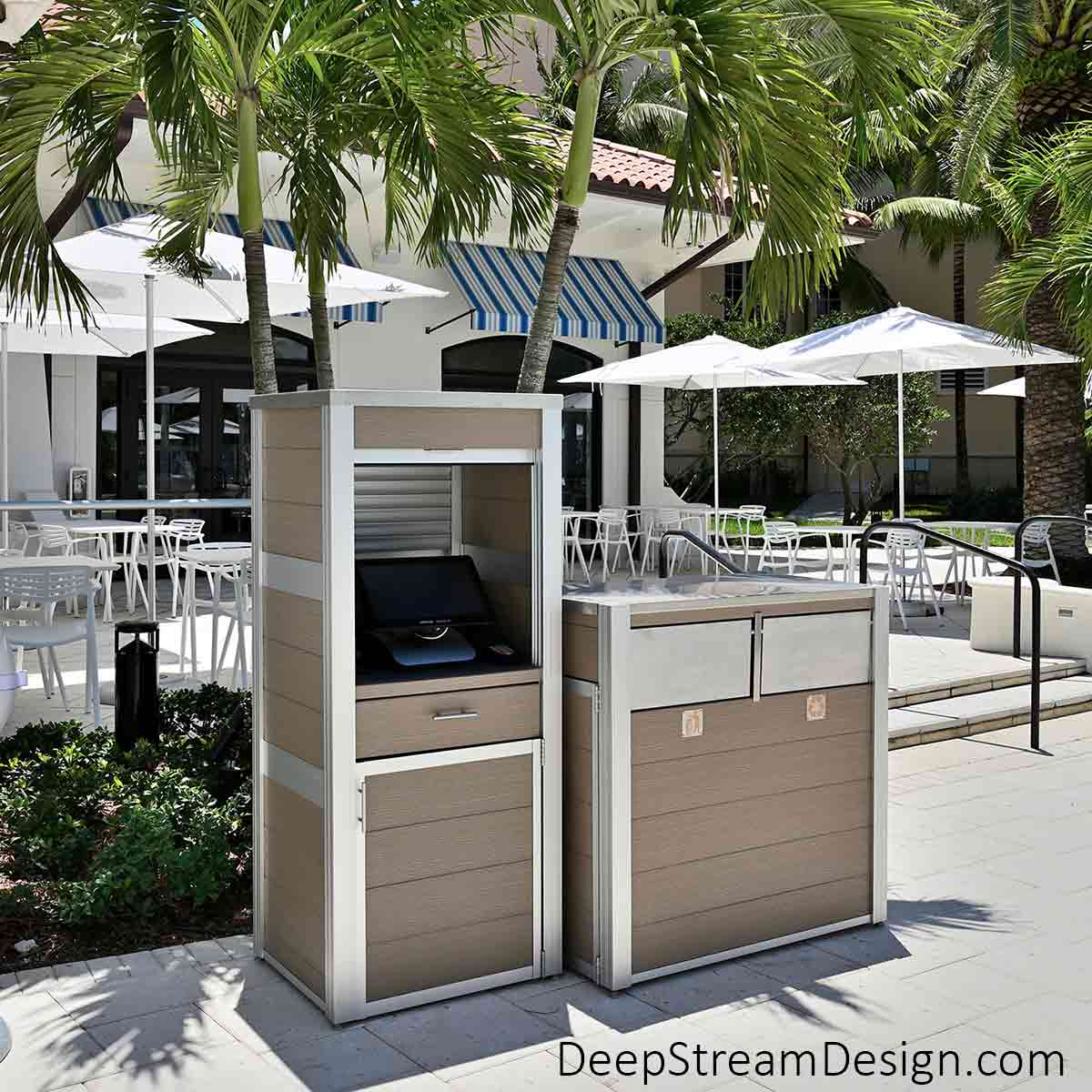 A Modern Commercial Recycling and Trash Bin on wheels next to a companion custom cabinet housing a remote point-of-sale-terminal at a tropical water park and restaurant complex. Both fixtures are made with 316 stainless steel lids, anodized aluminum legs, and maintenance free recycled plastic lumber.