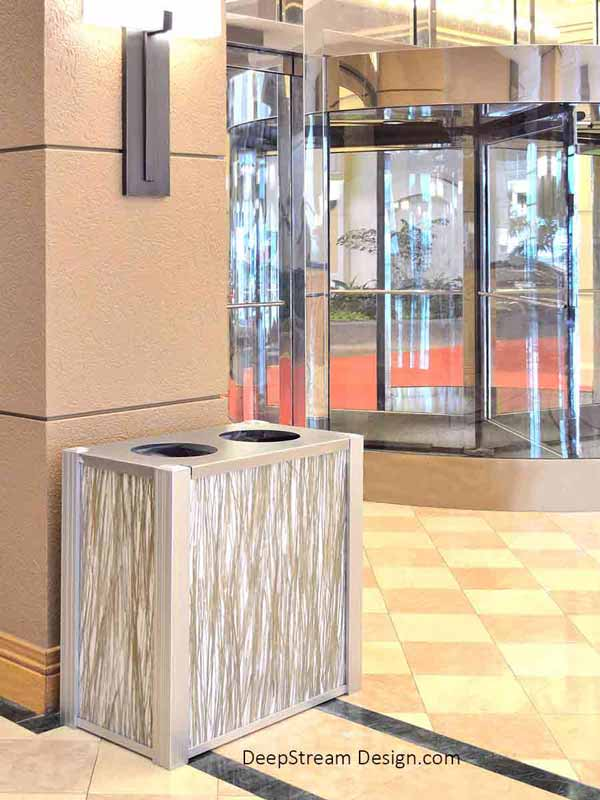 Audubon dual-stream Modern Commercial Combined Recycling and Trash Receptacle with 3-form Bear Grass 50 Percent Varia Ecoresin panels in a modern 5-Star hotel marble lobby.