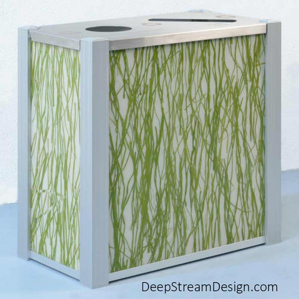Studio photo of an Audubon double-stream Modern Commercial Combined Recycling and Trash Receptacle with 3-form bright green ribbonlike Seaweed Varia Ecoresin panels.